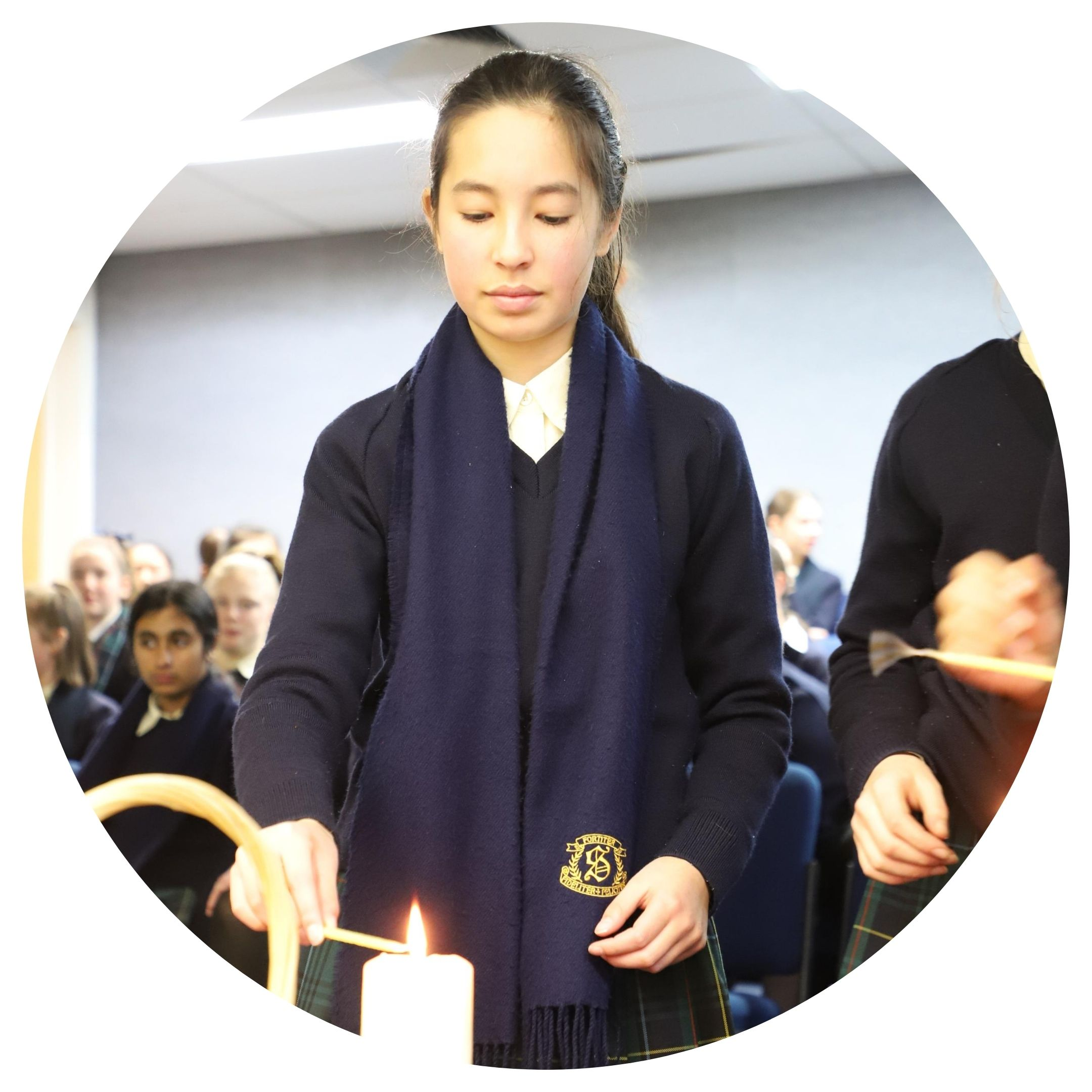 student lighting candle