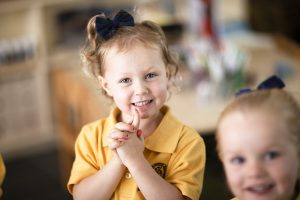 early learning student smiling